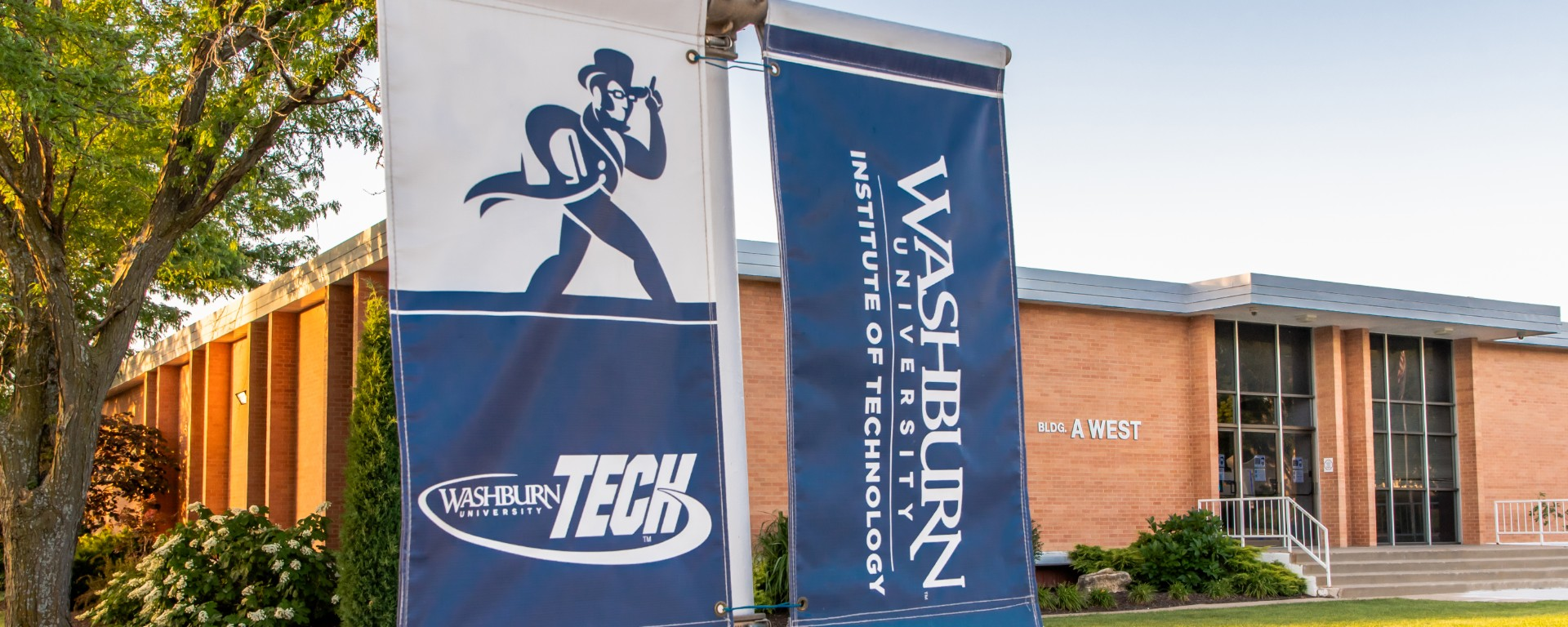 Washburn Tech exterior logo with grasses in foreground