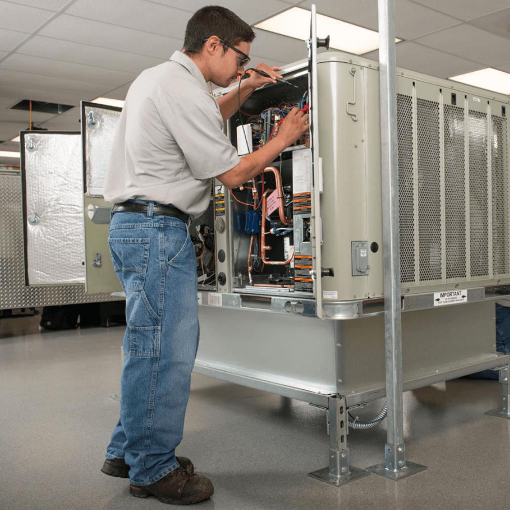 HVAC student working on equipment