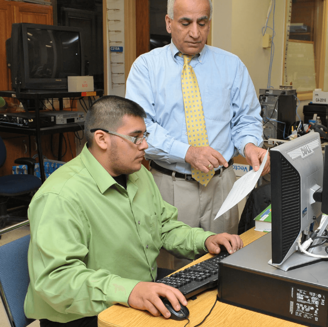 instructor and student in computer lab