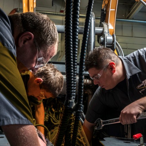 diesel mechanic students in the lab